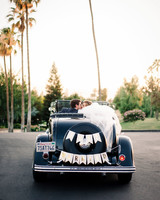 just married sign black classic car couple