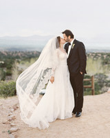 Bride with Long, Flowy Veil and Groom Kissing
