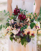 Peach and burgundy wedding bouquet with orchids