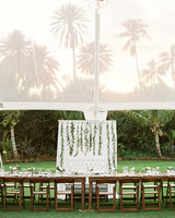 tulle reception tent with palm tree silhouettes