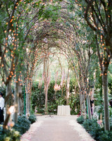 twinkle lights creating illuminated archway to ceremony