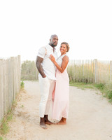 couple posing on sand path