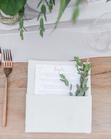 party napkins with guest names and greenery