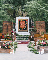 mismatched ceremony aisle with pillows and chairs