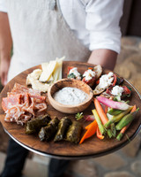 anika max wedding appetizers on round wooden platter