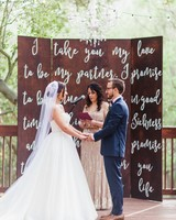 wedding ceremony backdrop white type on boards