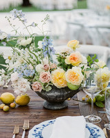 citrus colored floral centerpieces with citrus fruit table displays