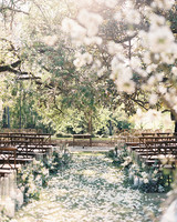 outdoor double wedding ceremony aisle lined with white flower petals