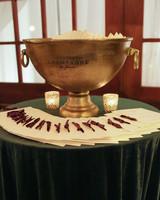 elizabeth seth wedding programs on table with large copper champagne bucket