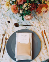 earth tone place settings with floral centerpieces