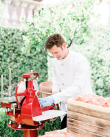 chef at wedding food station outdoors