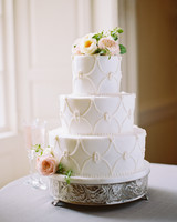 Three Tiered White Wedding Cake With Icing Beading And Flowers
