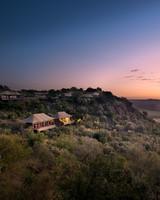 africa trip hillside camp sunset view