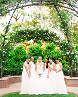 bride with sister bridesmaids in white gowns