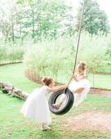 flower girls on tire swing