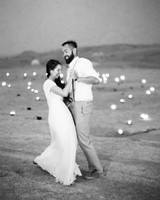 bride and groom share first dance in the desert surrounded by candles