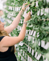 lauren josh wedding seating chart greenery wall