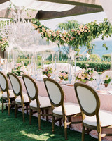 mykaela and brendon wedding blue and pink table setting with garland hanging above