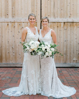 paige and kristine wedding brides in front of barn doors