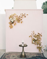 pink ceremony backdrop with leaves