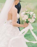 ribbon wedding ideas ribbon tied around white bridal bouquet