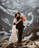 couple embracing on mountain