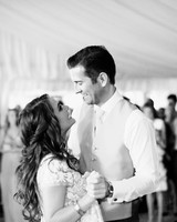 bride and groom smiling at each other during first dance