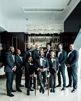 vanessa abidemi wedding groomsmen in front of bar