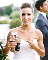 alcohol escort cards bride holding PBR in brown paper bag