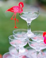 alcohol escort cards flamingo-adorned champagne tower