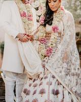 indian wedding bride and groom hindu ritual tying garments