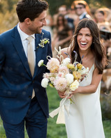 anika max wedding recessional bride and groom with bouquet of flowers