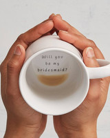 be my bridesmaid hands holding coffee mug