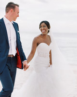 beach wedding dresses bride and groom holding hands