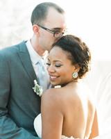 wedding groom kissing bride on head