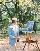 man creating plein air painting