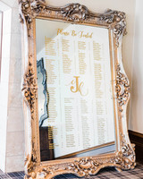 large gold framed mirror gold calligraphy seating chart
