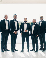 wedding groom and groomsmen in black tuxedos
