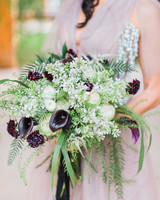 bouquet with purple calla lilies greenery and white flowers