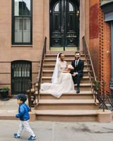 lola quinlan elopement couple sitting on stairs
