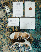 deckle edge wedding invitation with wax seal and bridal accessories