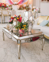 lounge area with mirrored table and decor with flowers