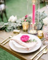 neon pink rose and candle at place setting