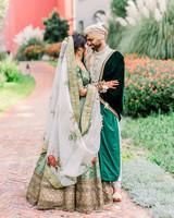 bride and groom hugging outside in garden area