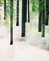 ribbon wedding ideas escort cards hanging from black ribbon