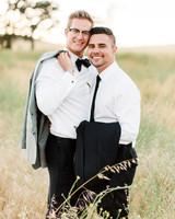 grooms smile in field portrait photo