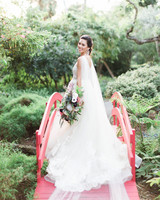 bride with King Proteas and blue thistles bouquet