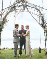 Intricate Wooden Wedding Arch with Foliage