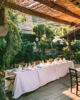 air bnb wedding venue table on wooden deck surrounded by plants