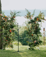 wedding ceremony backdrop flower walls framing hudson river